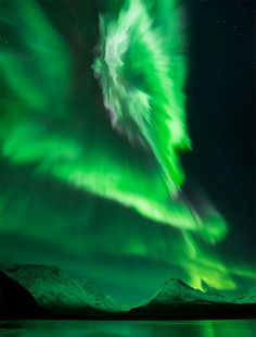 """EMERALD DYNAMITE:On Oct. 18th, Earth passed through multiple folds in the heliospheric current sheet--a phenomenon known as """"solar sector boundary crossings."""" This sparked a veritable explosion of bright auroras around the Arctic Circle. Ole Salomonsen of Tromso, Norway, captured the outburst in this photo, which he callsEmerald Dynamite."""