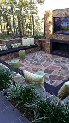 A little over the top with the TV .. But hey, I wouldn't complain. Outdoor stone and foliage entertainment space