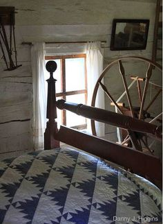 Blue & white traditional quilt in a primitive-style bedroom