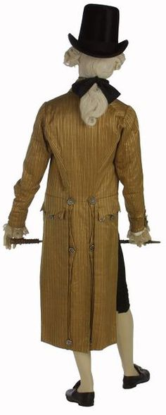 1795-1805: This double-breasted coat demonstrates the exaggerated style of the late 1790s. It has a very high turned-down collar and large revers (lapels). The coat is now cut straight across in front and, following the example of women's dress, the waistline is several inches above the natural level. The double-breasted style in both coats and waistcoats was a fashion that began in the 1780s.