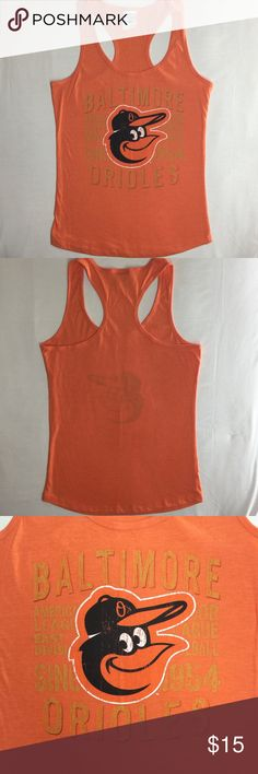 """MLB BALTIMORE ORIOLES SINCE WOMEN'S RACERBACK TANK NEW WITHOUT TAGS - NEVER WORN - OVERSTOCK ITEM - LINE THROUGH BRAND LABEL.   MLB BALTIMORE ORIOLES """"SINCE"""" WOMEN'S TANK    - BALTIMORE ORIOLES ESTABLISHED """"SINCE 1954"""" - MLB GENUINE MERCHANDISE BY CAMPUS LIFESTYLE  - DISTRESSED MLB TEAM GRAPHIC  - RACERBACK TANK  - SLEEVELESS - U-SHAPE HEM  - 50% COTTON, 50% POLYESTER  - MADE IN GUATEMALA CAMPUS LIFESTYLE Tops Tank Tops"""