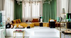 I rarely see a room that emerald green is used in such a masterful way.  the entire color combination is exceptional