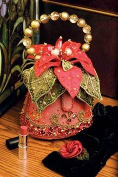 Mary Frances Holiday Poinsettia Purse: The legendary designer's limited hand bags are coveted collectibles.