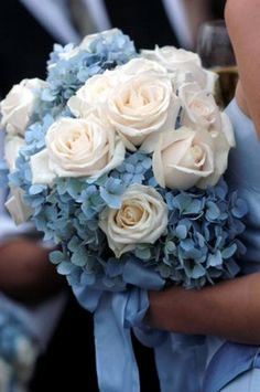 white roses and blue hydrangeas