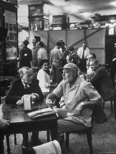 Premium Photographic Print: Noel Coward Chatting with Ernest Hemingway at Sloppy Joe's Bar by Peter Stackpole : 16x12in