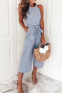 The Stripe Jumpsuit features a round neckline, sleeveless, tie front and length wide leg design. Details: Material: Cotton Blends Style: Bohemian Pattern Type: Striped Fit Type: Loose Clothing Length: Regular SIZE(IN) US Bust Waist Hip Pants Length S M Jumpsuit Casual, Jumpsuit Outfit, Capri Jumpsuit, Denim Jumpsuit, Elegant Jumpsuit, Summer Jumpsuit, Short Jumpsuit, Strapless Romper, Strapless Jumpsuit