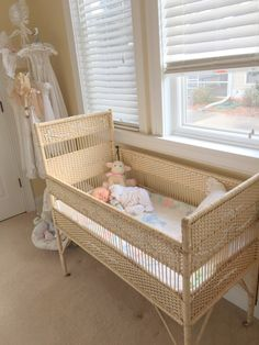 Antique English wicker crib. Love the embossed plaster flower garlands and bows.
