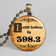 I still believe in 398.2 resin pendant, library charm, book necklace, fairy tale pendant.