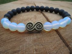 Check out this item in my Etsy shop https://www.etsy.com/listing/219362732/yinyang-bracelet-black-and-white