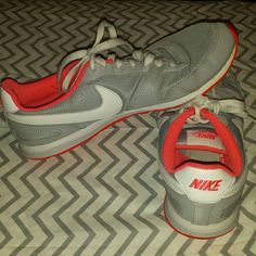 Nike shoes Size 8 Nike shoes. Grey/pink. Used condition. Still has a lot of life in them. Nike Shoes Athletic Shoes