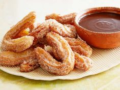 Cinnamon Churros with Mexican Chocolate Dipping Sauce courtesy Guy Fieri, Show: Guy's Big Bite, Episode: Dinner Bells