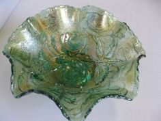 Imperial Carnival Glass Helios Green Open Rose 8 Inch Bowl. This bowl is 8 in diameter and is 3 deep. The design is elegant. Imperial