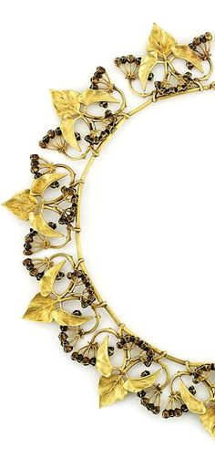AN ART NOUVEAU GOLD AND ENAMEL NECKLACE, BY LUCIEN GAILLARD Composed of a series of openwork chased panels depicting a spray of matted gold ivy leaves with black and brown enamel berries, to threaded curved bar-link necklace and bolt ring clasp, circa 1900, 39.7cm long, with original silk case containing a calling card from Mrs William Younger, with note to the reverse 'necklace formerly strung on wire, Robert Younger to Katharine Younger' Signed L. Gaillard