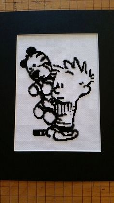 Calvin and Hobbes Cross Stitch pattern PDF by FeralCatStudio  (Perhaps a greyscale cross-stitch on white aida?)