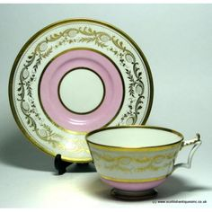 Worcester Flight Barr & Barr period tea cup & saucer c 1820-1825. There is an impressed crown FBB mark to the base of both the tea cup and saucer. The cup is of basic London shape with an indented French feathered handle, with gilded detailing and recess to the saucer. The rim of the bowl, saucer and foot rim are also gilded. There is a rococo design gilded band above a solid pink ground band.