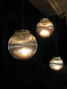 creat hanging candle holders with inexpensive bulb covers from the lighting department at Home Depot and some wire. pick thick durable ribbed glass so they'll hold up outside