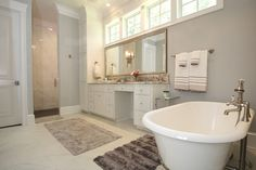 Everything in this bathroom says come in and relax from the custom white cabinetry to the claw tub and tile shower. The Claw, Custom Cabinetry, Bathtub, Relax, Shower, Bathroom, Design, Custom Closets, Standing Bath