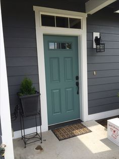 Home interior: happy teal front door top modern bungalow design exterior de Painted Exterior Doors, Design Exterior, Exterior Paint Colors For House, Paint Colors For Home, Navy House Exterior, Door Design, Paint Colours, Grey Exterior, Grey House Exteriors