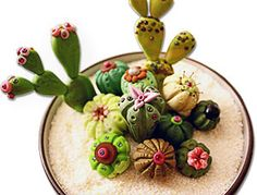 Illustrator Paula Pindroh created an intriguing polymer cactus garden series