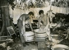 Two shirtless hunky GIs on laundry duty - World War II