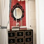 dens/libraries/offices - white capiz chandelier red fretwork wallpaper glossy black Dorothy Draper chest ikea Ung Drill black mirror frame  Red