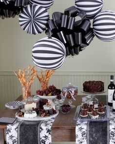 Ebony Party. We love this ebony color scheme for a wine and cheese party. The elegant decorations are the perfect backdrop for a sophisticated soiree.