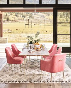 Please Let Me Live In The Anthropologie Catalog #refinery29  http://www.refinery29.com/2016/10/127988/anthropologie-house-and-home-fall-2016#slide-5  Pink dining room chairs, FTW.Elowen Armchair, $448.00, available at Anthropologie....