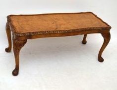 Antique Queen Anne style walnut coffee table of excellent quality. The top is burr walnut & the shaped top edge is nicely carved. There is also very good carving on the well shaped legs. It's in good condition, having just been French polished & I would say it dates to around the 1930's period.