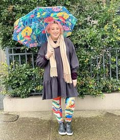 Kim matches the colors in her umbrella to her leggings | 40plusstyle.com Interview Style, Short Rain Boots, Tracksuit Pants, How To Wear Leggings, Girls Rules, Her Style, Colorful Leggings, Outfit Of The Day, What To Wear