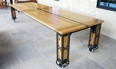 Vance Harvest Dining Table - Built from  recycled steel and reclaimed Oak and Hickory. Shown with 5″ casters, but also available without. Available in custom sizes and designs.