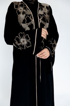 Featuring gorgeous mink floral embroidery and delicate gold beads, this abaya is a must-have piece. Matching scarf is included. Made in the UAE. Arab Fashion, Muslim Fashion, Sewing Collars, Black Abaya, Mode Abaya, Pakistani Dresses Casual, Abaya Designs, Queen Dress, Clothing Patterns