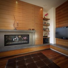 #tbt A look back to 2007. The Great Room fireplace and Entertainment Unit at our Orchard House in South Calgary, custom built from book matched walnut and honed concrete.  #alloyhomes #yyc #calgary #customhomes #yycarchitecture #yycdesign #yychomes #capturecalgary #calgaryviews #explorecalgary #exploreyyc #loveyyc #madeinyyc #mycalgary #yyclife