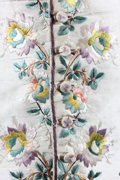 Detail embroidery, waistcoat, c. 1790-1800. Cream eau de nil silk embroidered in floss silks in shades of mauve, green and pink, dandelion clock sprigs, line back panels
