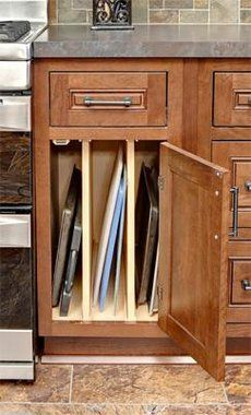 CliqStudios' tray base cabinet is the perfect solution for storage of cookie sheets, baking pans, pizza pans and cutting boards. Now these otherwise awkward sized items are easy to store and easy to find. a must have in my kitchen Kitchen Cabinet Drawers, Kitchen Cabinet Hardware, Storage Cabinets, Kitchen Cabinets, Narrow Cabinet, Brown Cabinets, Cabinet Handles, Kitchen Storage Solutions, Kitchen Organization