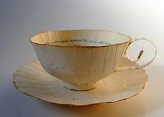 Cecilia Levy recreates everyday objects from the pages of old books - Made In Slant Paper Tea Cups, Food Sculpture, Paper Sculptures, Cup Art, Christmas Paper Crafts, Paper Artist, Environmental Art, Everyday Objects, Vintage Tea