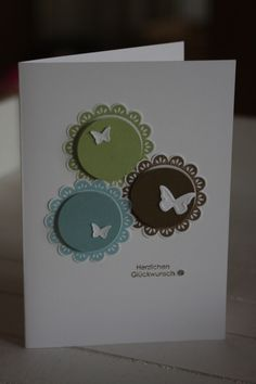 handmade card ... clean and simple ... grouping of three circles matted on scallop and topped with a butterfly ...