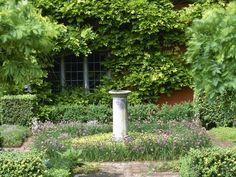 natural garden design with small bird feeder