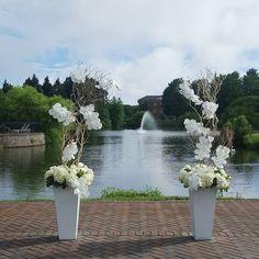 a break in the rain!  #ishafossdesign #flowers #virginiabeachflorist #wedding #altar #manzanita #orchids #foundersinn by ishafoss