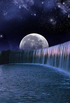 Moon falls over a dam.