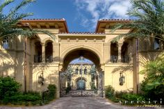 European Italianate Estate...Love The Private Entrance, Huge Wall Sconces, & Iron Gate