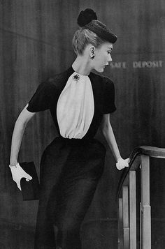 Sophie Malgat, May Vogue 1951  Sophie is wearing a black silk shantung dress with a half black and white stole slipped through the neckband.