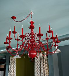 painted chandelier - I've got two in the house that are going to be transformed.  Just need to figure out the color. Love the red!