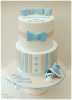 Christening cake with bow tie and baby shoes