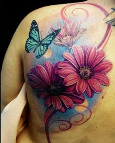 Pink daisies and blue butterflies tattoo