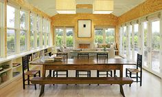 Panoramic view  A wall of windows and four sets of French doors enhance the vineyard views of this Sonoma County home. Low-profile storage is provided underneath the windows so as to not obstruct the view.