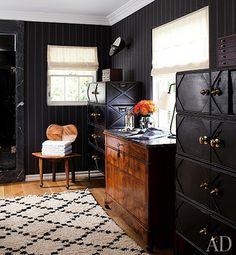 perfect matching ebony dressers accentuating dark walls & warm walnut hued hardwood floors...