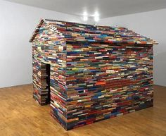 fort made of books.  that is so epic.