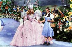 The Wizard of Oz 1939 Billie Burke Judy Garland. Dorothy meets Glinda the good witch. Judy Garland, Glenda The Good Witch, Wizard Of Oz 1939, Wizard Of Oz Movie, Billie Burke, Which Witch, Iconic Dresses, Yellow Brick Road, Actors