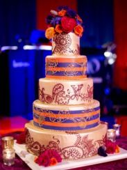 Our very elaborate wedding cake with our LV monogram in mehndi design and incorporating the purple and orange our wedding colors! Maharani Weddings