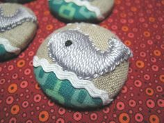 Whale embroidered buttons! So many ideas....